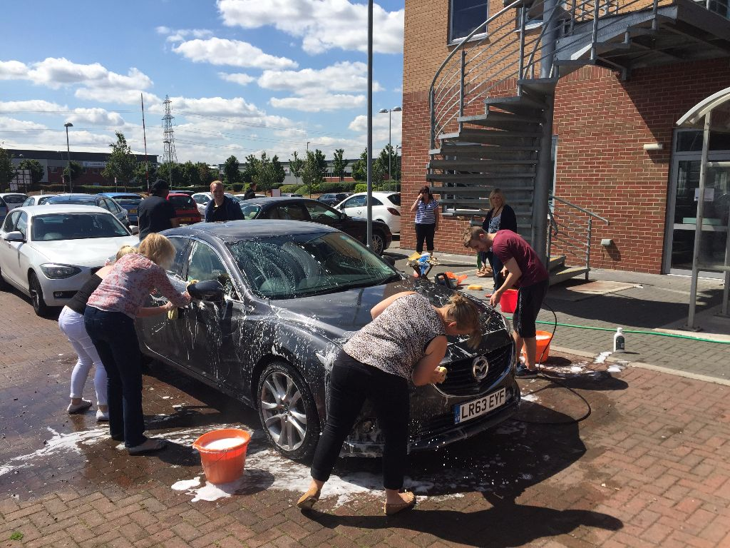 The team washed cars for CRUK